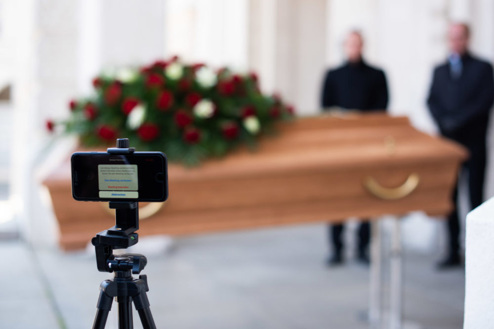 Undertakers rehearsing a live streamed funeral. (Thomas Kronsteiner/Getty Images)