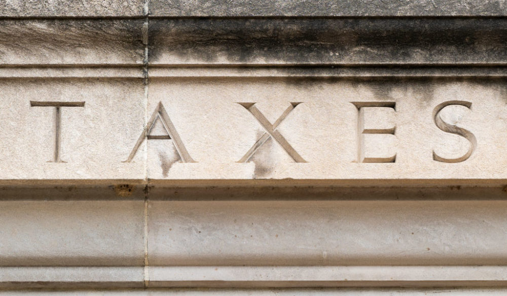 "The word ""TAXES""  is seen on the facade of the Internal Revenue Service building in Washington on Tuesday, July 7, 2020. (Bill Clark/CQ-Roll Call, Inc. via Getty Images)"