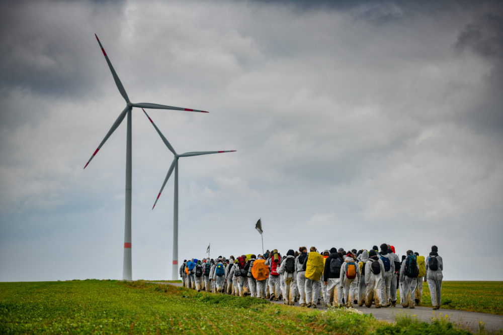 "Climate activists march in an attempt to occupy the Garzweiler open-cast coal mine and nearby gas infrastructure on a day of civil disobedience organized by the ""Ende Gelaende"" movement on September 26, 2020 near Grevenbroich, Germany. (Sascha Schuermann/Getty Images)"