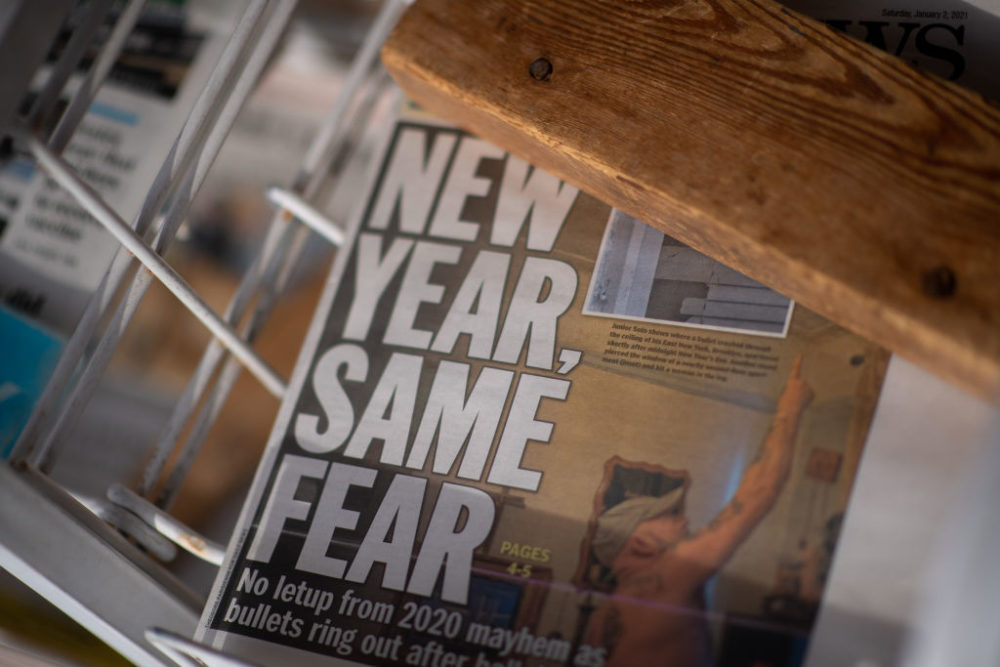 "A newspaper with a headline stating ""NEW YEAR, SAME FEAR"" is displayed on Jan. 2, 2021 in Rehoboth Beach, Delaware. (Mark Makela/Getty Images)"