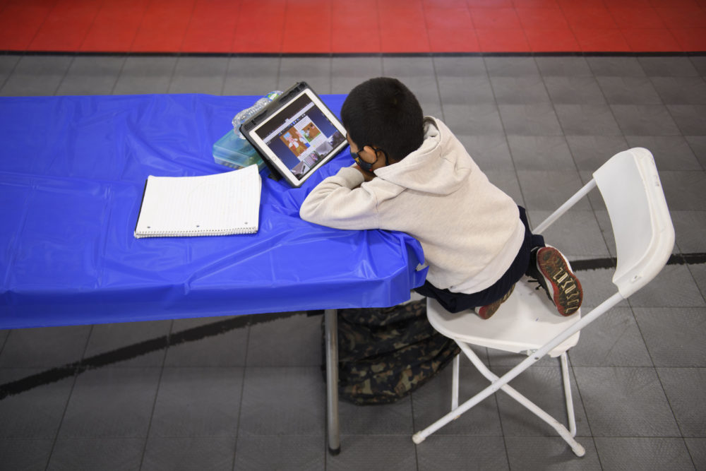 A child attends an online class at a learning hub inside the Crenshaw Family YMCA during the pandemic in February in Los Angeles, California. The learning hub program provides structured distance education resources including free WiFi, electricity, staff support, academic tutoring, and recreation activities to provide a safe environment to support low income and minority communities. (PATRICK T. FALLON/AFP via Getty Images)