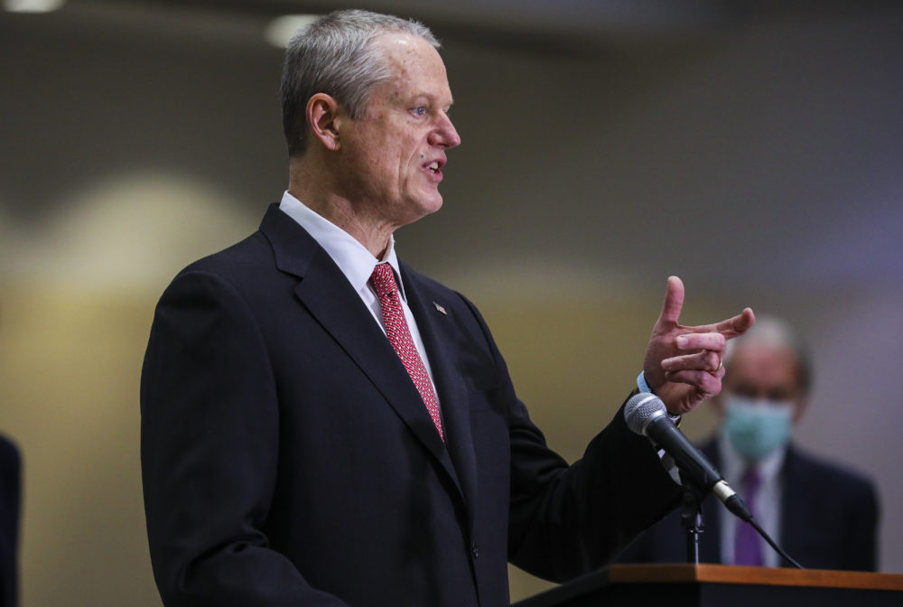 Gov. Charlie Baker speaks to press at the Hynes Convention Center FEMA Mass Vaccination Site on March 30, 2021 in Boston. (Erin Clark-Pool/Getty Images)