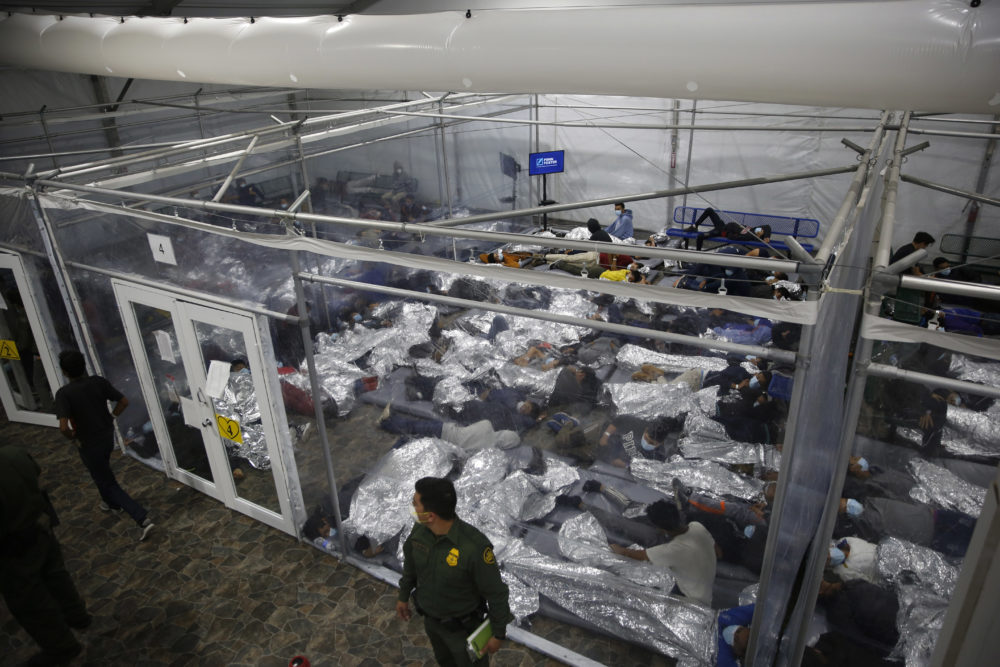 Young children lie inside a pod at the Department of Homeland Security holding facility run by the Customs and Border Patrol (CBP) on March 30, 2021 in Donna, Texas. (Dario Lopez-Mills - Pool/Getty Images)