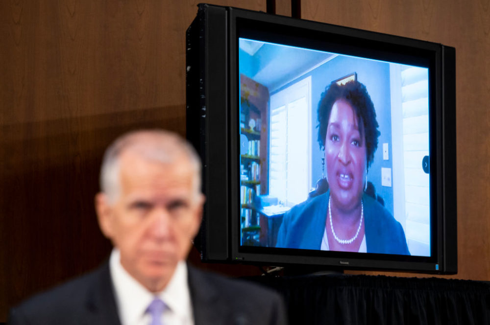 Sen. Thom Tillis, R-N.C., left, listens as Stacey Abrams, founder of Fair Fight Action, speaks during the Senate Judiciary Committee hearing on Jim Crow 2021: The Latest Assault on the Right to Vote on Tuesday, April 20, 2021. (Bill Clark/CQ-Roll Call, Inc via Getty Images)
