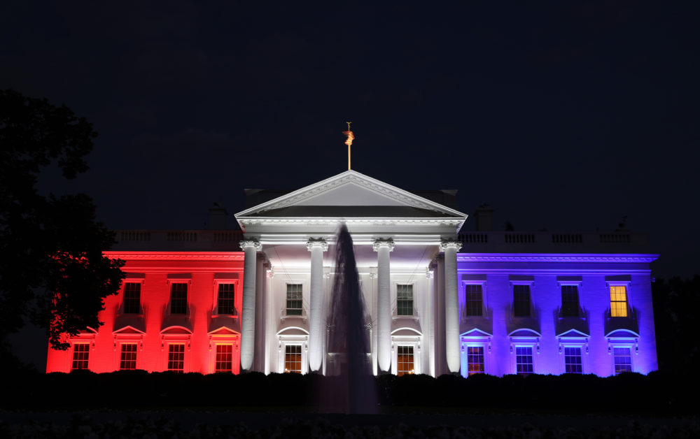 """The White House is bathed in red, white and blue light as part of the Fourth of July celebration July 4, 2020 in Washington, DC. President Trump is hosting a """"Salute To America"""" celebration that includes flyovers by military aircraft and a large fireworks display. (Photo by Win McNamee/Getty Images)"""