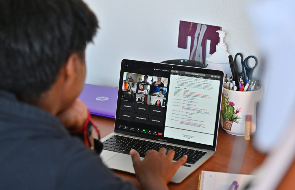 A college freshman participates in a Zoom meeting for an 'Introduction to Psychology' course. (Sam Wasson/Getty Images)