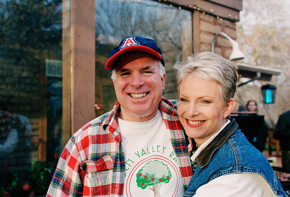 Presidential candidate John McCain (L) and his wife, Cindy McCain, smile for the camera at their family ranch, March 9, 2000, near Sedona, Arizona. (David Hume Kennerly/Getty Images)