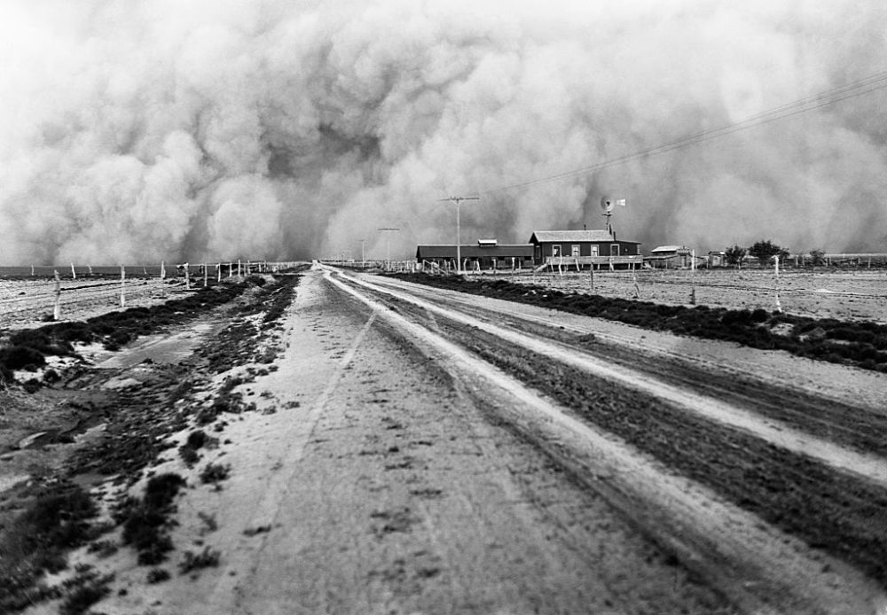 A farm about to be enveloped by a dust storm during the great Dust Bowl of the 1930s. (Corbis via Getty Images)