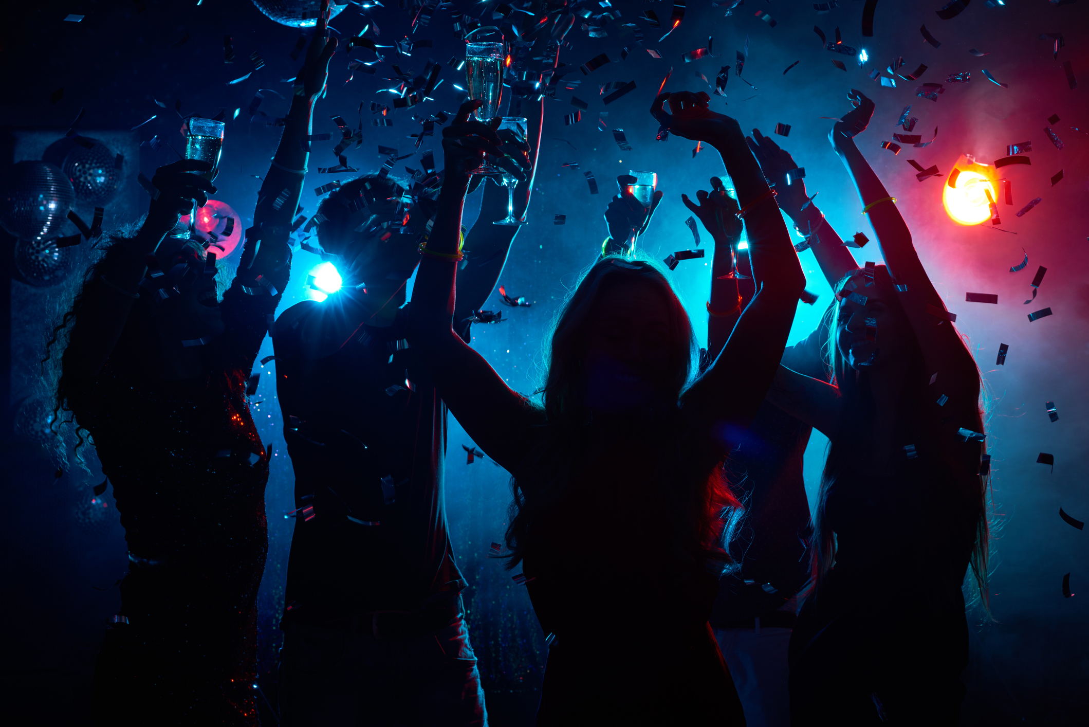 A group of people partying. (Getty Images)