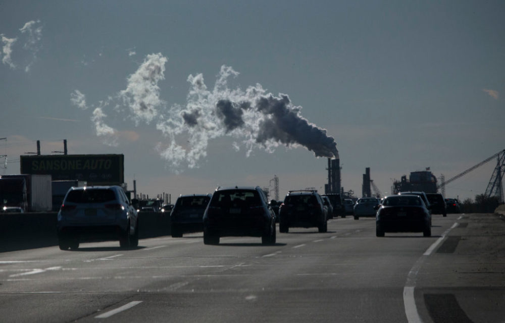 Vehicles move along the the New Jersey Turnpike while a factory emits smoke on November 17, 2017 in Carteret, New Jersey.  (Kena Betancur/VIEWpress/Corbis/Getty Images)