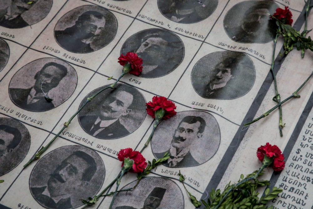 Roses lay on the portraits of victims during a memorial to commemorate the mass killings of Armenians in 1915 on April 24, 2018 in Istanbul, Turkey. (Chris McGrath/ Getty Images)