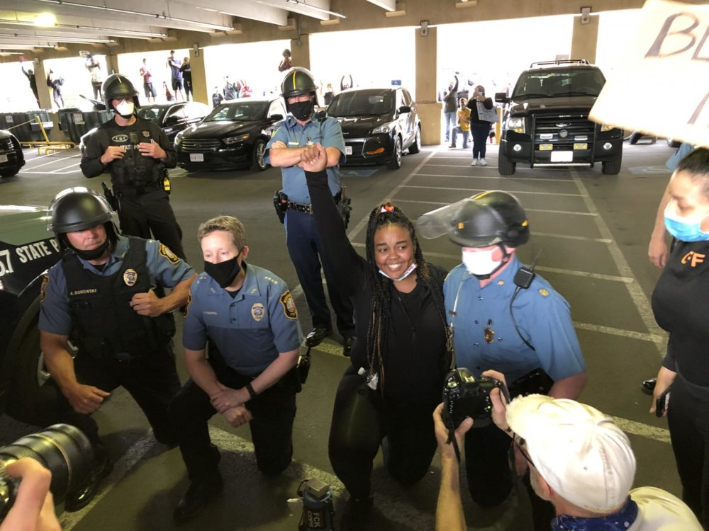 Northampton, Massachusetts, Police Chief Jody Kasper, kneeling second from left, with protesters last summer. (Alden Bourne / NEPR)