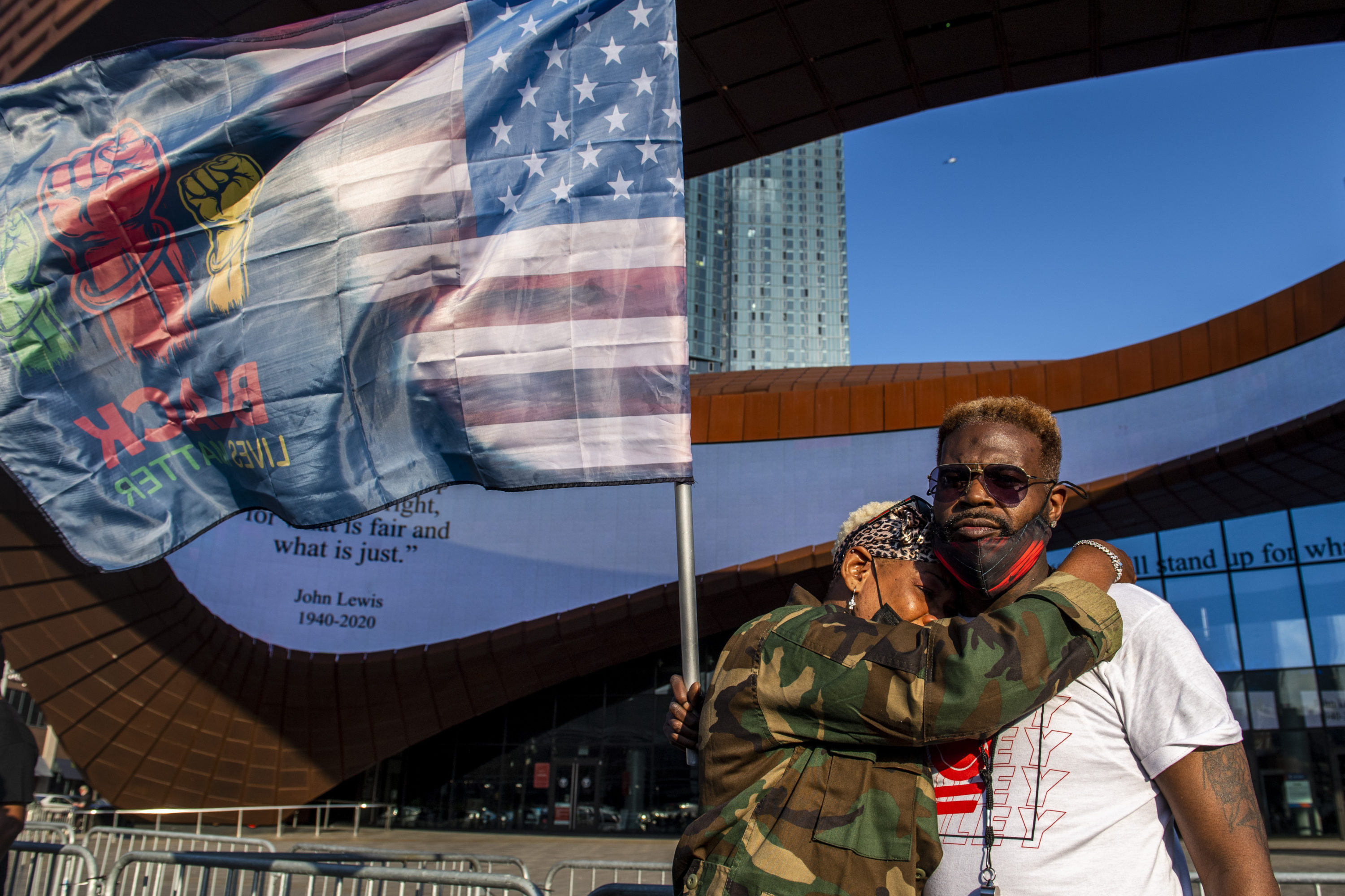 Ingrid Noel, 51, left, weeps on the shoulder of Robert Bolden, at a rally outside the Barclays Center on Tuesday in the Brooklyn borough of New York. (Brittainy Newman/AP)
