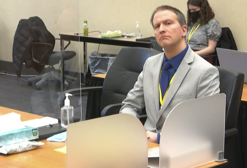 In this image from video, former Minneapolis police Officer Derek Chauvin listens as his defense attorney Eric Nelson gives closing arguments as Hennepin County Judge PeterCahill preside Monday in the trial of Chauvin at the Hennepin County Courthouse in Minneapolis. (Court TV via AP, pool)