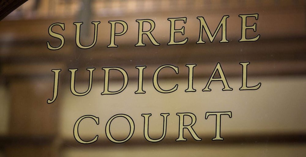 Supreme Judicial Court sign at the John Adams Courthouse in Boston. (Robin Lubbock/WBUR)