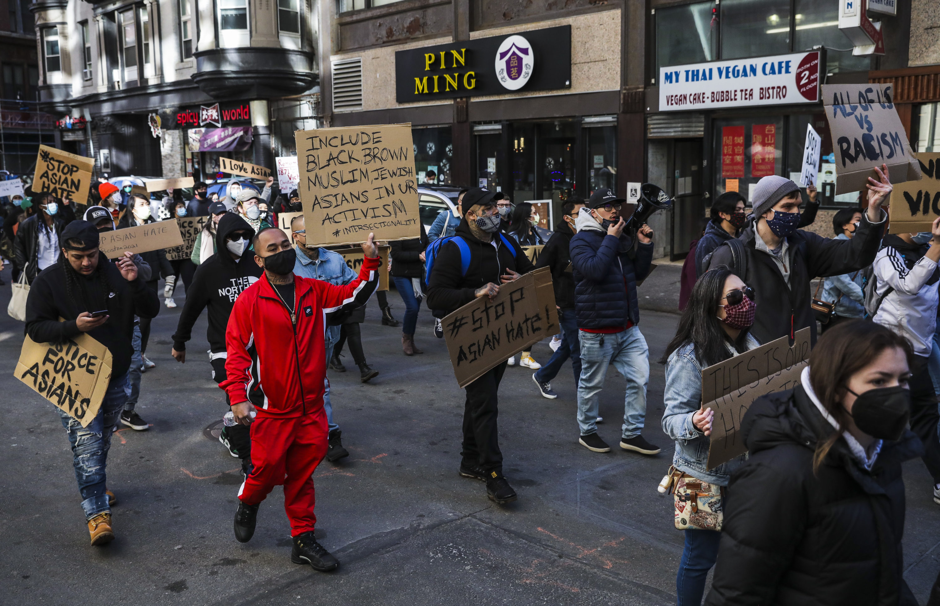 """Hundreds marched through Chinatown en route to the State House during a """"Stop Asian Hate"""" rally in Boston on March 13. (Erin Clark/The Boston Globe via Getty Images)"""