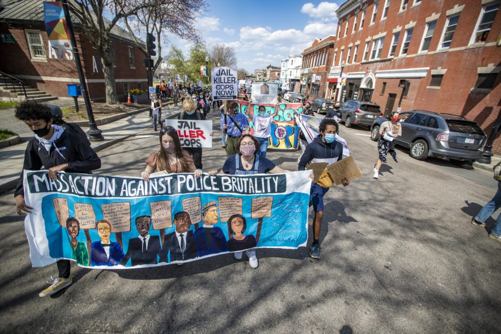 Protesters walked down Dorchester Avenue in Fields Corner during the Mass. Action Against Police Brutality rally and march. (Jesse Costa/WBUR)