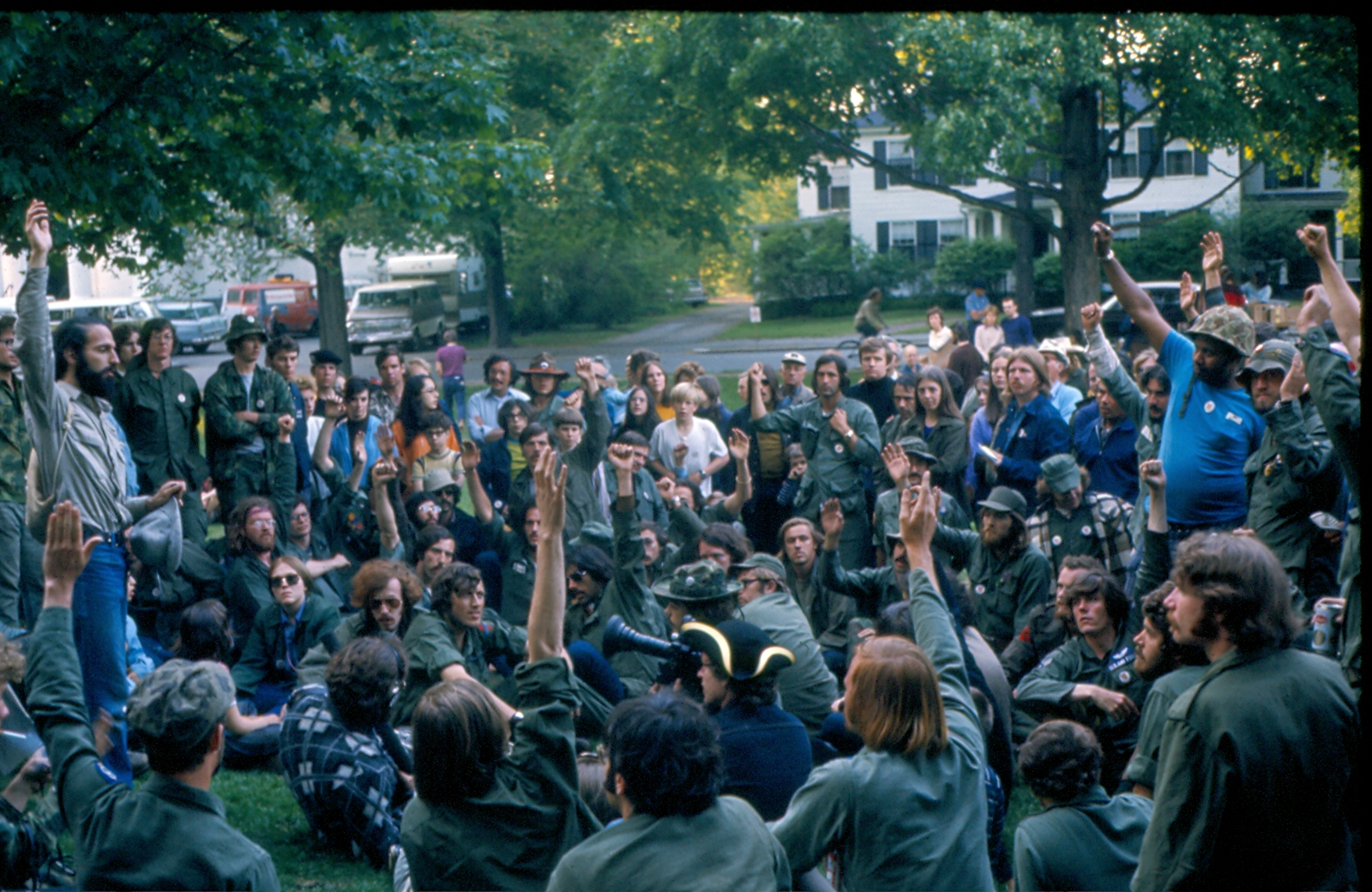 Chris Gregory (seated on lower right with Air Force wings on his fatigues) and other veterans take a vote on the green after being served an injunction from the Lexington Select Board about whether or not to commit civil disobedience. (Courtesy Richard Robbat)