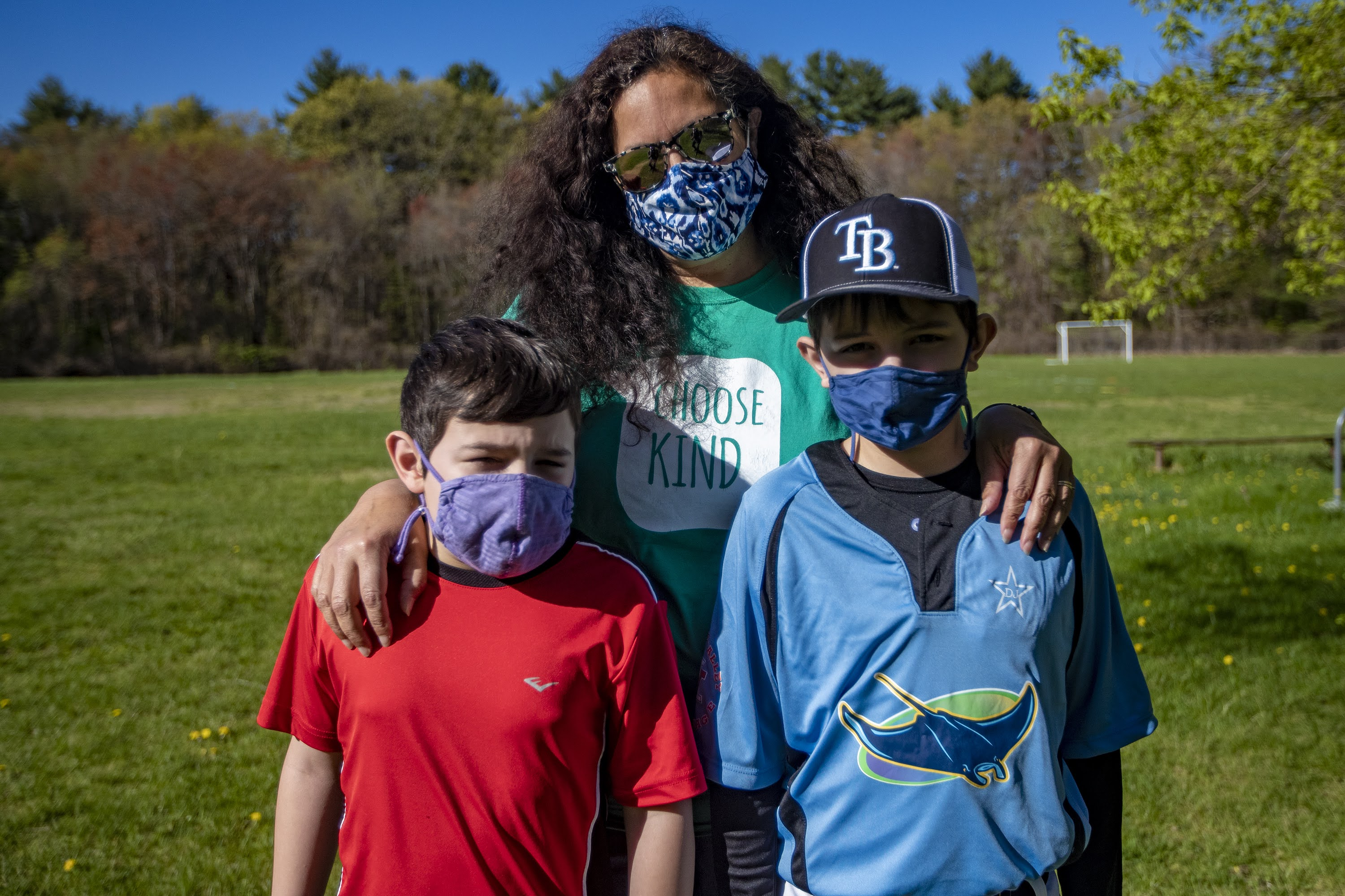 Alex Waldron, center, with her two sons Benjamin, 9, and Thomas, 11, in Maynard. (Jesse Costa/WBUR)