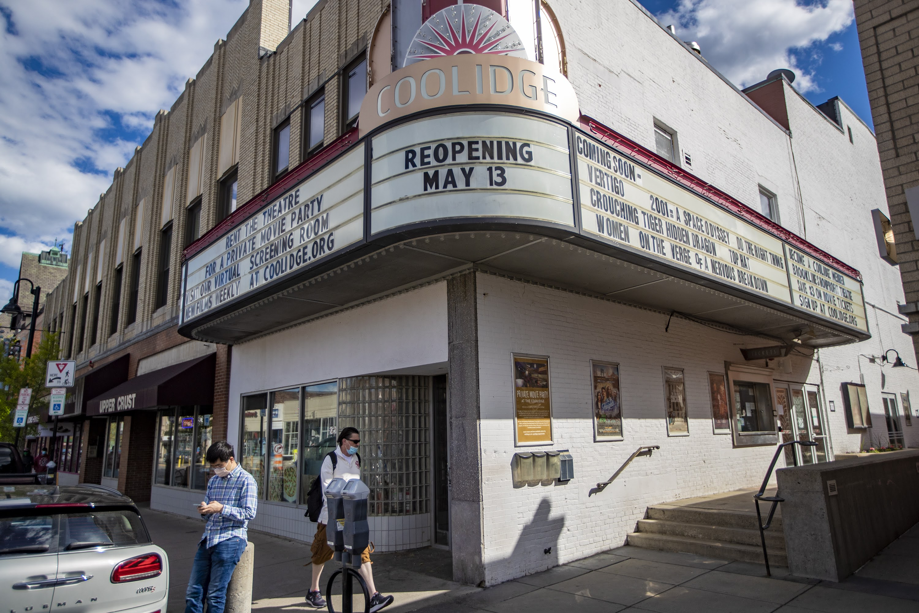 The marquee of the Coolidge Corner Theater annouces their reopening on May 13 after being closed to the public for 14 months due to the pandemic. (Jesse Costa/WBUR)