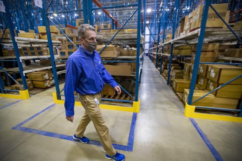 CEO Rick Green walks through the 1A Auto Parts distribution center in Littleton. (Jesse Costa/WBUR)