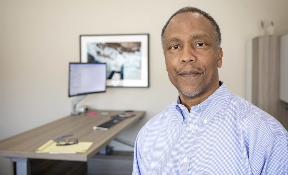 Anthony Samuels, CEO of DRB Facility Services, at his office in Copley Place, Boston. (Robin Lubbock/WBUR)