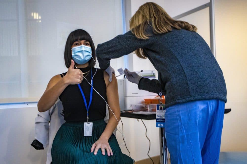 Dr. Gabriela Andujar Vazquez receives the first coronavirus vaccine administered at Tufts Medical Center on Dec. 15, 2020. (Jesse Costa/WBUR)