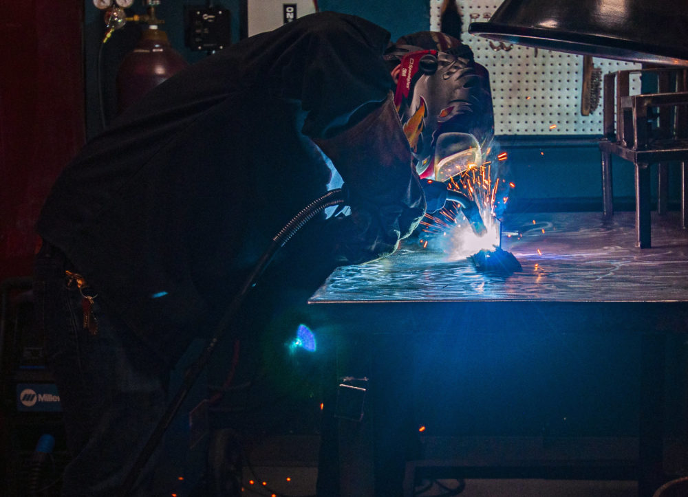 Anthony Grochowski welding at the Jane Addams Resource Corporation (JARC). (Chris Bentley/Here & Now)