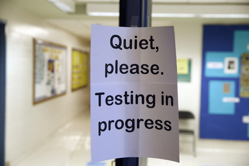 A sign is seen at the entrance to a hall for a college test preparation class. (Alex Brandon/AP)