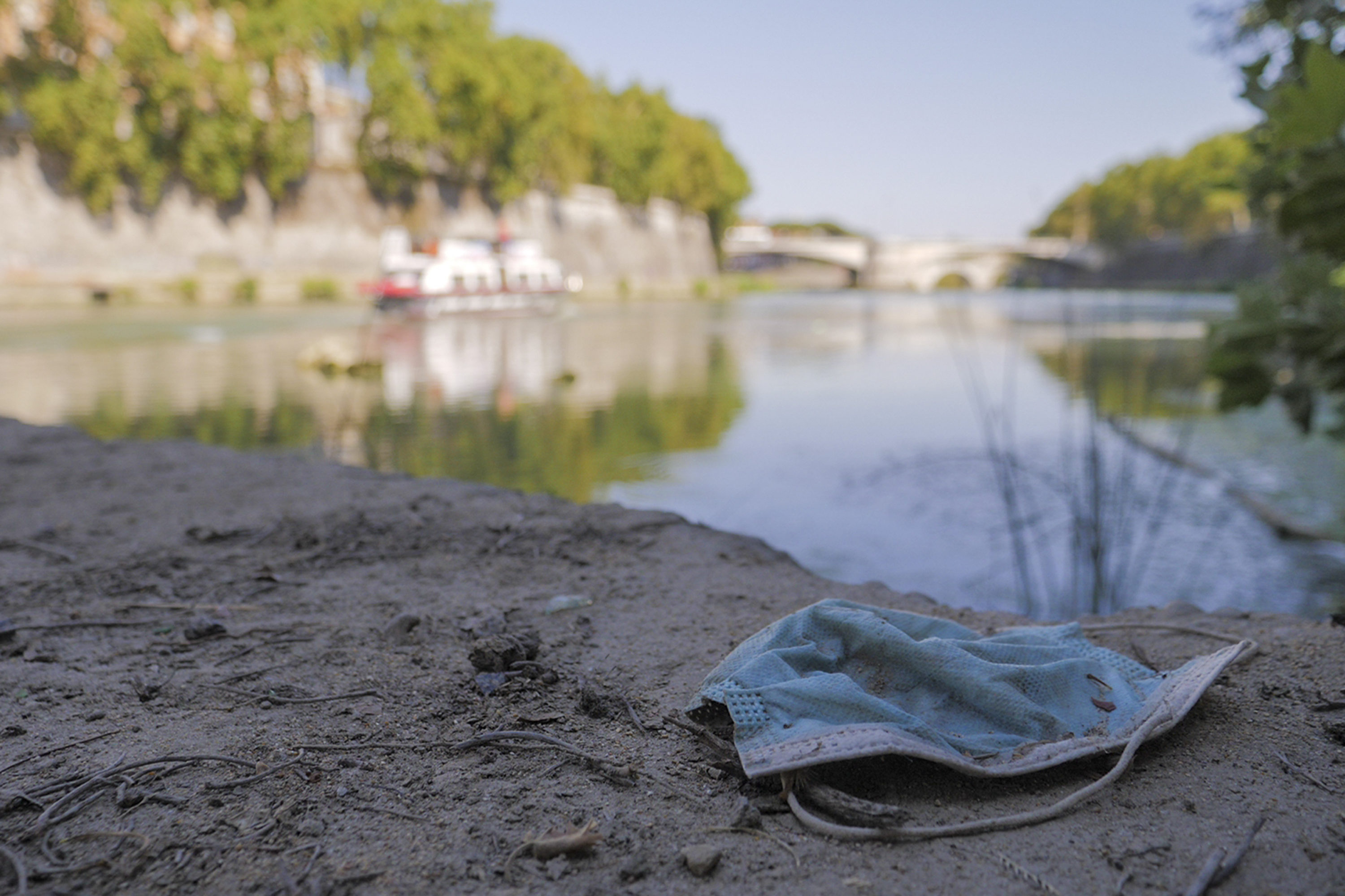 A face mask thrown on the ground. (Paolo Santalucia/AP)