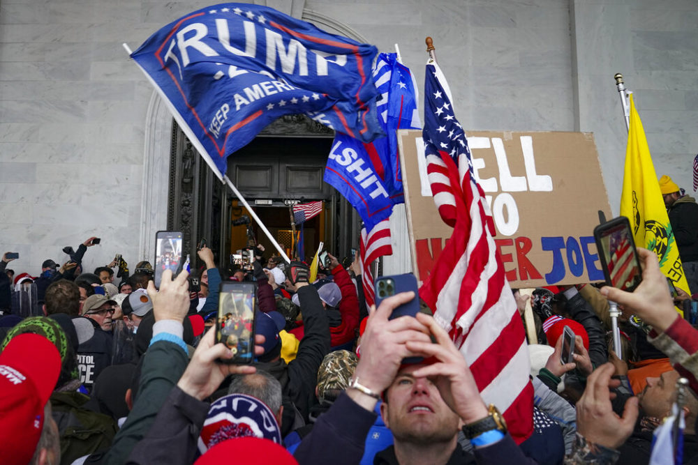 In this Jan. 6, 2021, file photo, Trump supporters gather outside the Capitol in Washington. (John Minchillo, File/AP)
