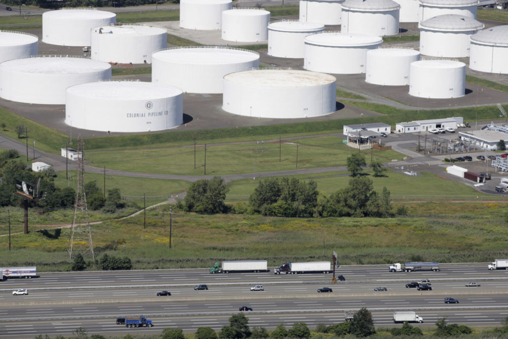 Traffic on I-95 passes oil storage tanks owned by the Colonial Pipeline Company in Linden, N.J. on Sept. 8, 2008. A major pipeline that transports fuels along the East Coast says it had to stop operations because it was the victim of a cyberattack. (Mark Lennihan/AP)