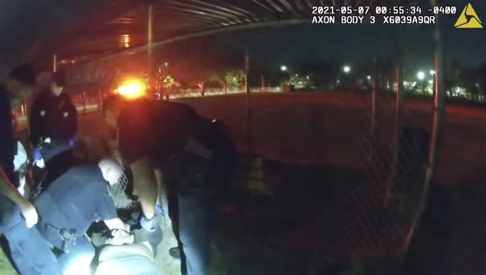 This photo taken from Providence Police body camera shows officers responding to a call Friday, May 7, 2021 of a man who was screaming outside in Providence, R.I. State authorities are investigating the case of the man who died after being handcuffed by police. (Providence Police Department via AP)