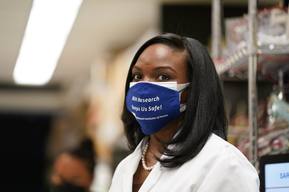 In this Feb. 11, 2021, file photo, Kizzmekia Corbett, an immunologist with the Vaccine Research Center at the National Institutes of Health looks on at the Viral Pathogenesis Laboratory at the NIH in Bethesda, Md. (Evan Vucci/AP File)