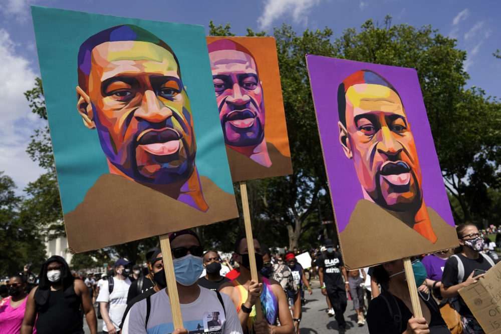 People carry posters with George Floyd on them as they march from the Lincoln Memorial to the Martin Luther King Jr. Memorial in Washington, D.C. (Carolyn Kaster/AP)