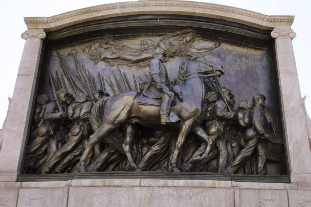 In this March 26, 2011, file photo, soldier and cavalry details are displayed on the memorial to Union Col. Robert Gould Shaw and the 54th Massachusetts Volunteer Infantry Regiment, near the Statehouse in Boston. The monument in Boston honoring a famed Civil War unit of Black soldiers has been unveiled May 28 following a $3 million restoration. (AP Photo/Michael Dwyer, File)