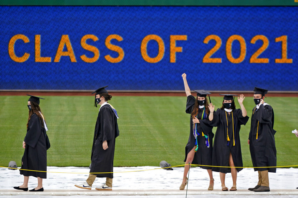 University of Pittsburgh candidates for graduation line up to receive their diplomas during the graduation ceremony for the Kenneth P. Dietrich School of Arts and Sciences and the School of General Studies at PNC Park in Pittsburgh, May 4, 2021.(Gene J. Puskar/AP)