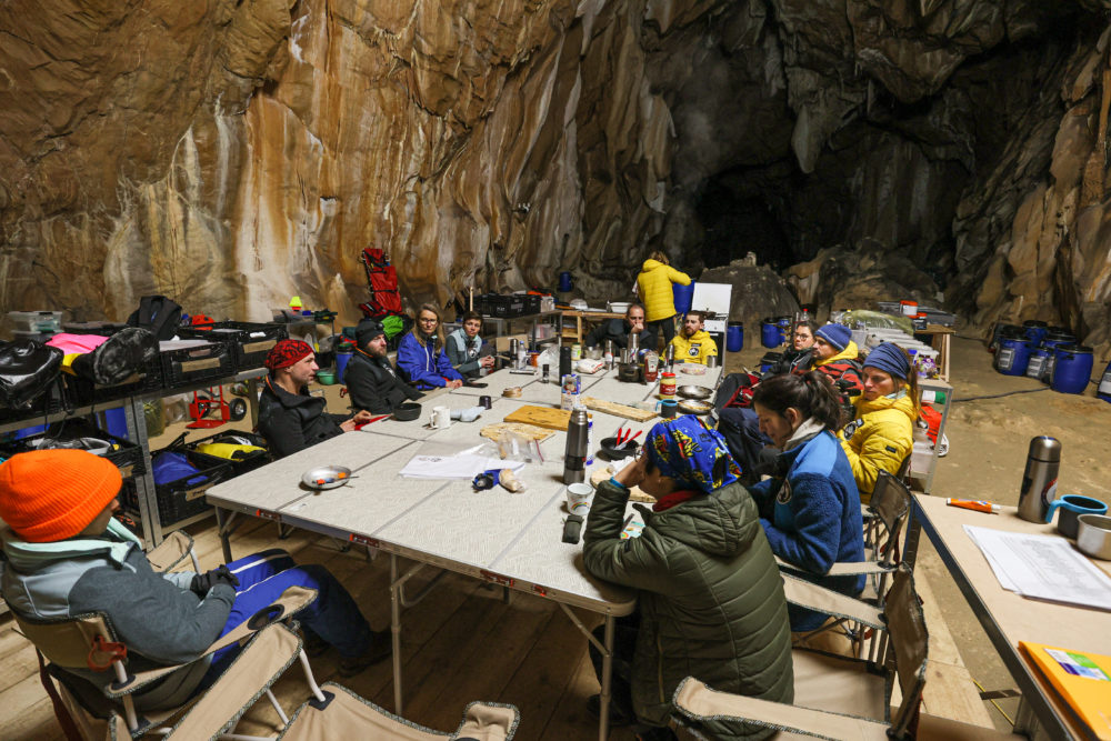 A group of people in a cave with no way to tell the time. (Deep Time © Human Adaptation Institute)