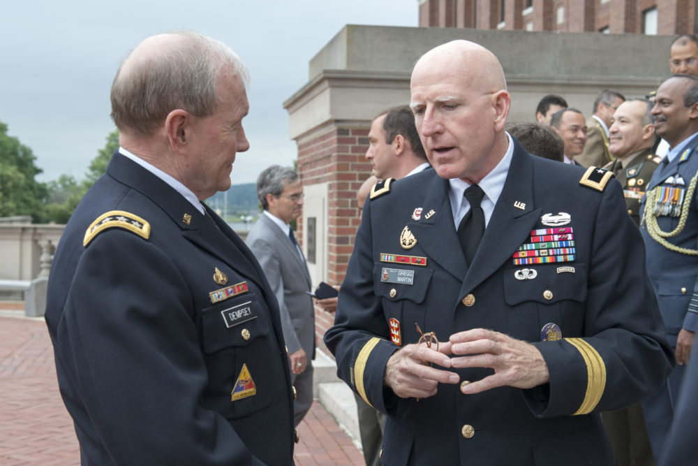 Maj. Gen. Gregg Martin, president of National Defense University in Washington D.C. speaks with Chairman of the Joint Chiefs of Staff Gen. Martin Dempsey in June of 2014. (Courtesy Dept. of Defense; photo by Specialist 1st Class Daniel Hinton)