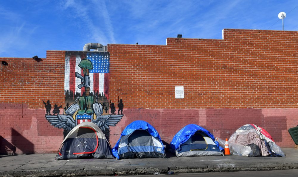 Tents for the homeless line a sidewalk in Los Angeles, California on December 17, 2019. (Frederic J. Brown/AFP via Getty Images)