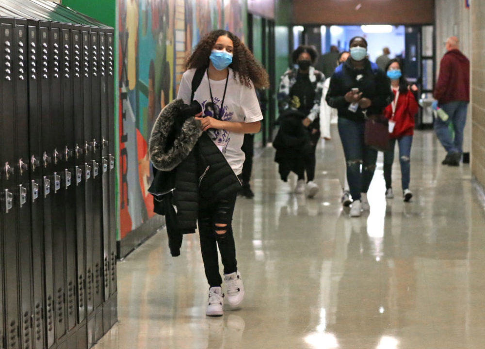 Freshman students walk the hallway in between classes during the bell break, which normally would be packed by students, at Brockton High School in Brockton, Mass. on March 2, 2021. (David L. Ryan/The Boston Globe via Getty Images)