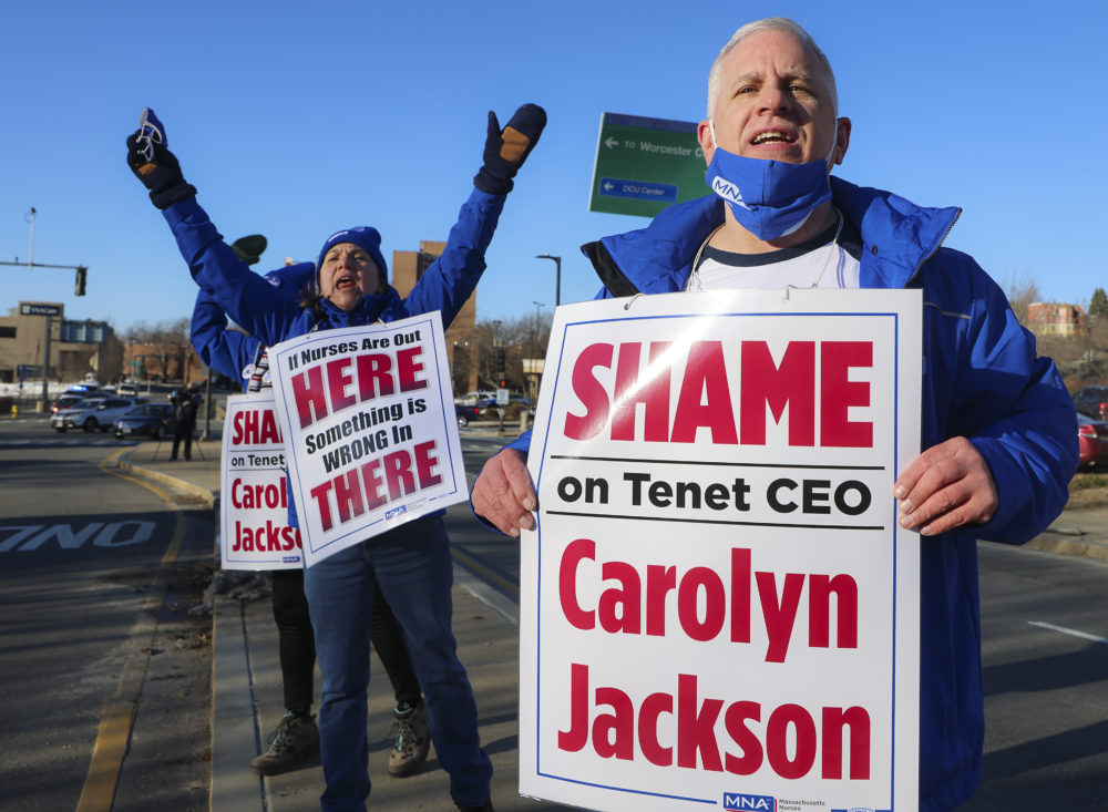 Paul Stuart, a tech at St. Vincent, and Betty Ann Warner, a 40 year veteran RN at the hospital, get the group of more than 300 fired up as the union nurses announce a strike in Worcester, MA on March 7, 2021. (Matthew J. Lee/The Boston Globe via Getty Images)
