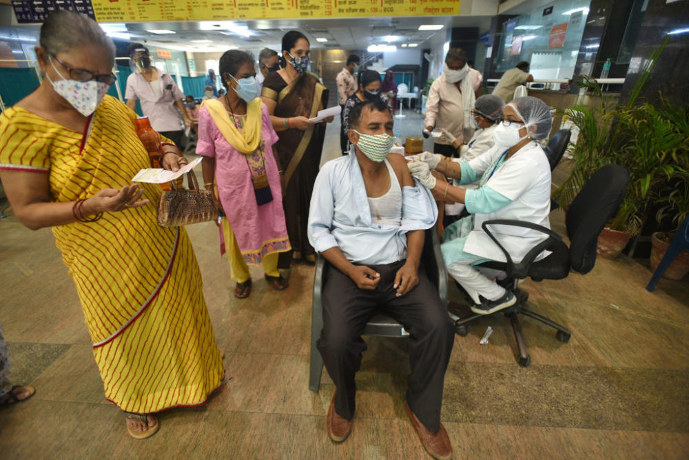 A man being vaccinated against COVID-19, at a district hospital in Noida, India. (Sunil Ghosh/Hindustan Times via Getty Images)