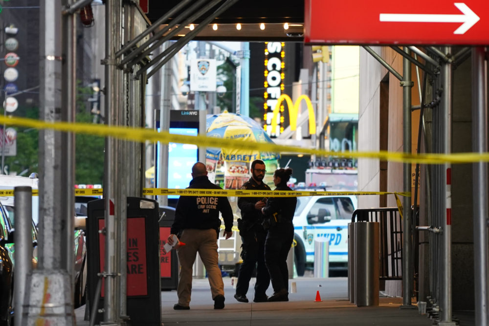 Police officers are seen next to marked shell casings from a gun in Times Square on May 8, 2021 in New York City. According to reports, three people, including a toddler, were injured in the shooting. (David Dee Delgado/Getty Images)