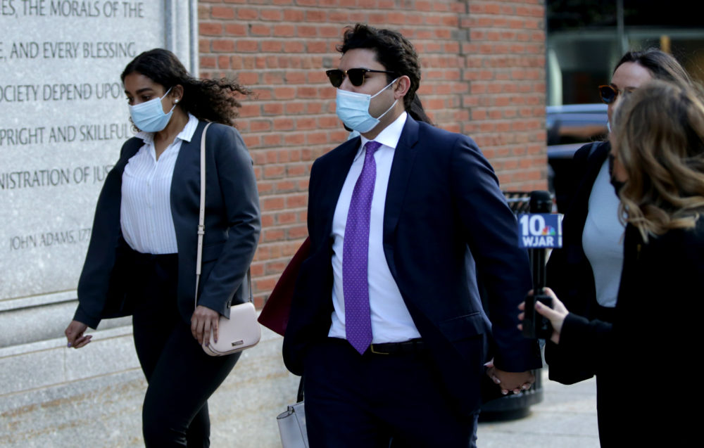 Former Fall River Mayor Jasiel Correia, center, arrives at federal court in South Boston. He did not take questions as he headed to federal court in Boston on May 11, 2021. (Jonathan Wiggs/The Boston Globe via Getty Images)