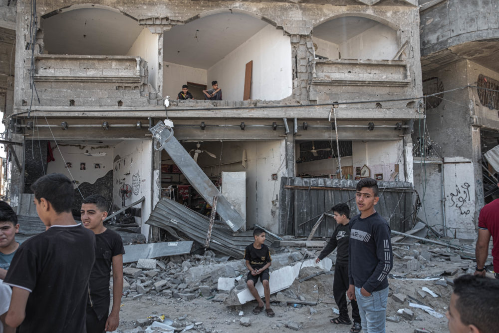 Palestinians inspect damage to buildings in Al-Saftawi street northern Gaza City on May 20, 2021 in Gaza City, Gaza. (Fatima Shbair/Getty Images)