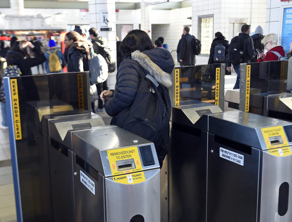 MBTA passengers pass through automated fare collection gates at JFK/UMass Station in Boston on April 4, 2019. (Christopher Evans/MediaNews Group/Boston Herald via Getty Images)