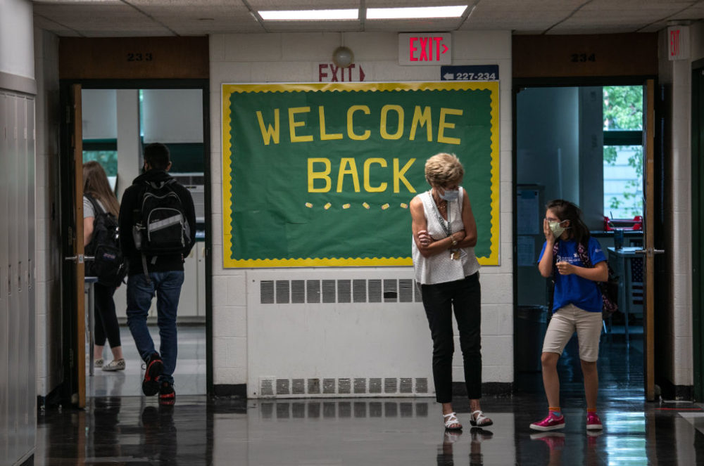 A teacher speaks with a student between classes at Rippowam Middle School on September 14, 2020 in Stamford, Connecticut. (John Moore/Getty Images)