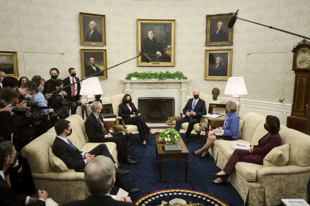 President Joe Biden speaks to the press during a meeting with (L-R) Transportation Secretary Pete Buttigieg, Sen. Mike Crapo (R-ID), Vice President Kamala Harris, Sen. Shelley Capito (R-WV), and Commerce Secretary Gina Raimondo, to discuss the administration's infrastructure plan at the White House on May 13, 2021 in Washington, D.C. (T.J. Kirkpatrick-Pool/Getty Images)