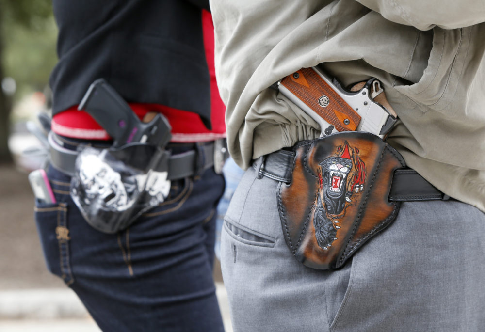 Two people carrying pistols in Texas. (Erich Schlegel/Getty Images)